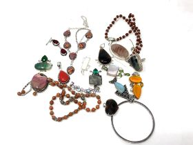 A collection of mostly white metal and silver jewellery, bangles, pendants etc.