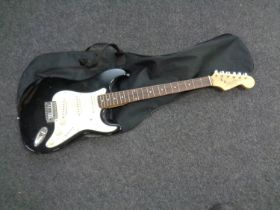 A Liberty 303 Stratocaster style electric guitar in soft carry case together with a further empty