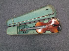 """An early 20th century violin with 14"""" two-piece back, unlabelled, with later bow,"""