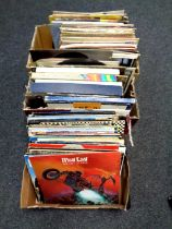 Four boxes containing a large quantity of LP records including Meatloaf, Blondie, Status Quo,
