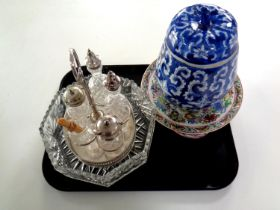 A tray containing silver plated cruet set on gallery stand,