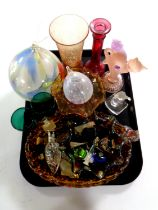 A tray containing 20th century glassware including amber glass bowl, petrol glass, paperweights,