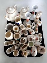 A tray containing a large quantity of crested china