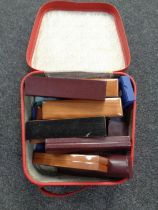 A leather case containing a quantity of empty jewellery boxes
