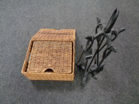 A five piece companion set on stand together with a set of three graduated wicker baskets