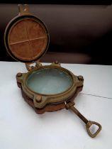 A brass porthole