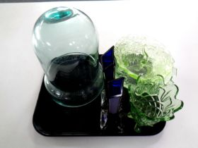 A tray of glassware to include pair of blue glass slender vases, green glass bowls,