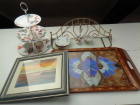 A tray containing cake stand, glass and brass shelf, china flower posy,