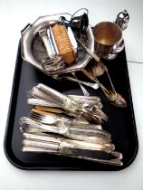 A tray containing a quantity of plated cutlery, small trophy cup, sugar sifter,