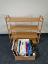 A contemporary book rack together with a box containing a small quantity of books relating to