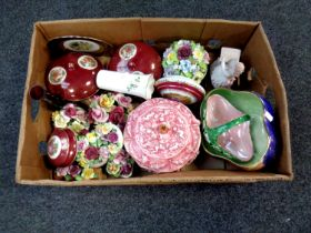 A box of ceramics including Maling storm bowl, china flower posies,