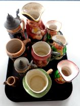 A tray containing German pottery beer steins,
