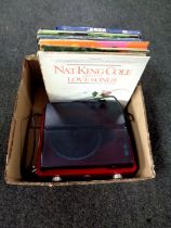 A box containing GPO turntable together with a small quantity of LP records,