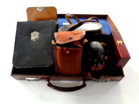 Two leather brief cases containing cast metal money box, leather cased travel set, boxed pen knife,