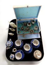 A tray containing boxed Fabrique Francaise miniature tea set, willow pattern blue and white tea set,