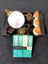 A box containing Hornsea storage jars, Kodak camera, light shade, boxed raven head glasses,