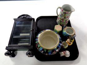 A tray containing miniature ebonised glazed cabinet, Newport Pottery Sylvian bowl,