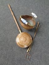 A Victorian copper and porcelain handled coal bucket together with a bed warming pan,