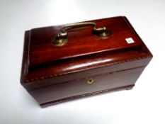 A George III inlaid mahogany tea caddy with fitted interior