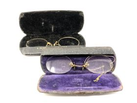 Two pairs of antique spectacles