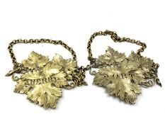 A very fine pair of ornate large silver gilt decanter labels, heavily cast for Sherry and Port,