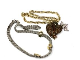 Two costume necklaces together with two brooches