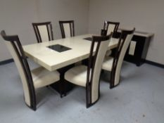 A contemporary simulated marble rectangular dining table together with matching three door