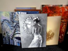 A quantity of wall canvases and prints,