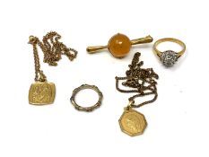 Two religious pendants on chains, dress ring,