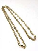 A long gold plated chain on silver