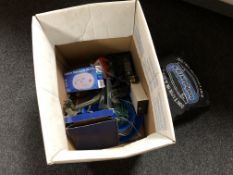 A box containing remote control helicopter, bodyelastic kit,