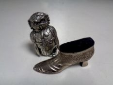 A pin cushion in the form of a shoe together with one other
