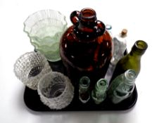 A tray containing bottles bearing various names including one bottle marked W B Reid and Co.