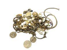 A small quantity of costume jewellery, religious pendants, crucifix,