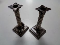A pair of late Victorian Corinthian column silver candlesticks, Sheffield 1897,