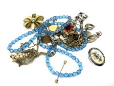 A small quantity of costume jewellery, brooches,