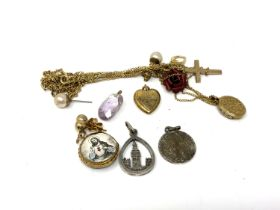 A small quantity of costume pendants, heart locket, crucifix,