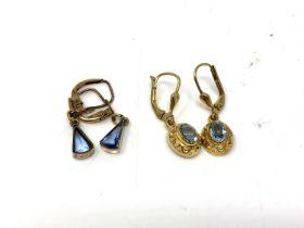 Two pairs of yellow metal earrings