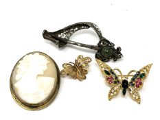 Four costume brooches to include cameo,