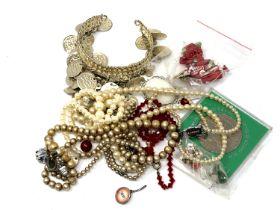 A quantity of costume jewellery, cuff bangle,
