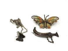 A silver filigree butterfly brooch together with a further butterfly on chain