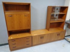 A 20th century teak modular sideboard fitted cupboards and drawers