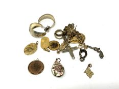 A small quantity of costume jewellery, pendants, miniature pistol charm,
