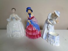 A Royal Doulton figure, Victorian Lady, together with two further figures, HN3235 Mother and Baby,