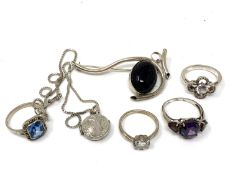 A silver brooch together with dress rings,