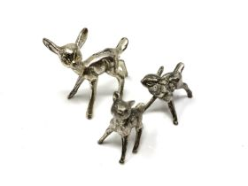 Three silver plated fawns