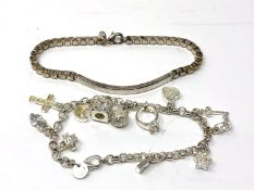 A white metal charm bracelet together with a further bracelet