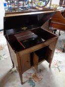 An Edwardian mahogany gramophone cabinet