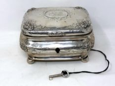 A 19th century German silver tea caddy, coat of arms to lid, on ball feet, original silver key.