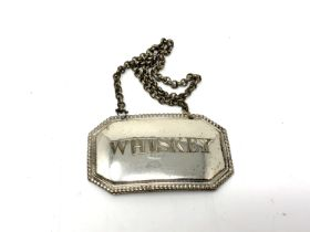 A silver plated decanter label - whisky
